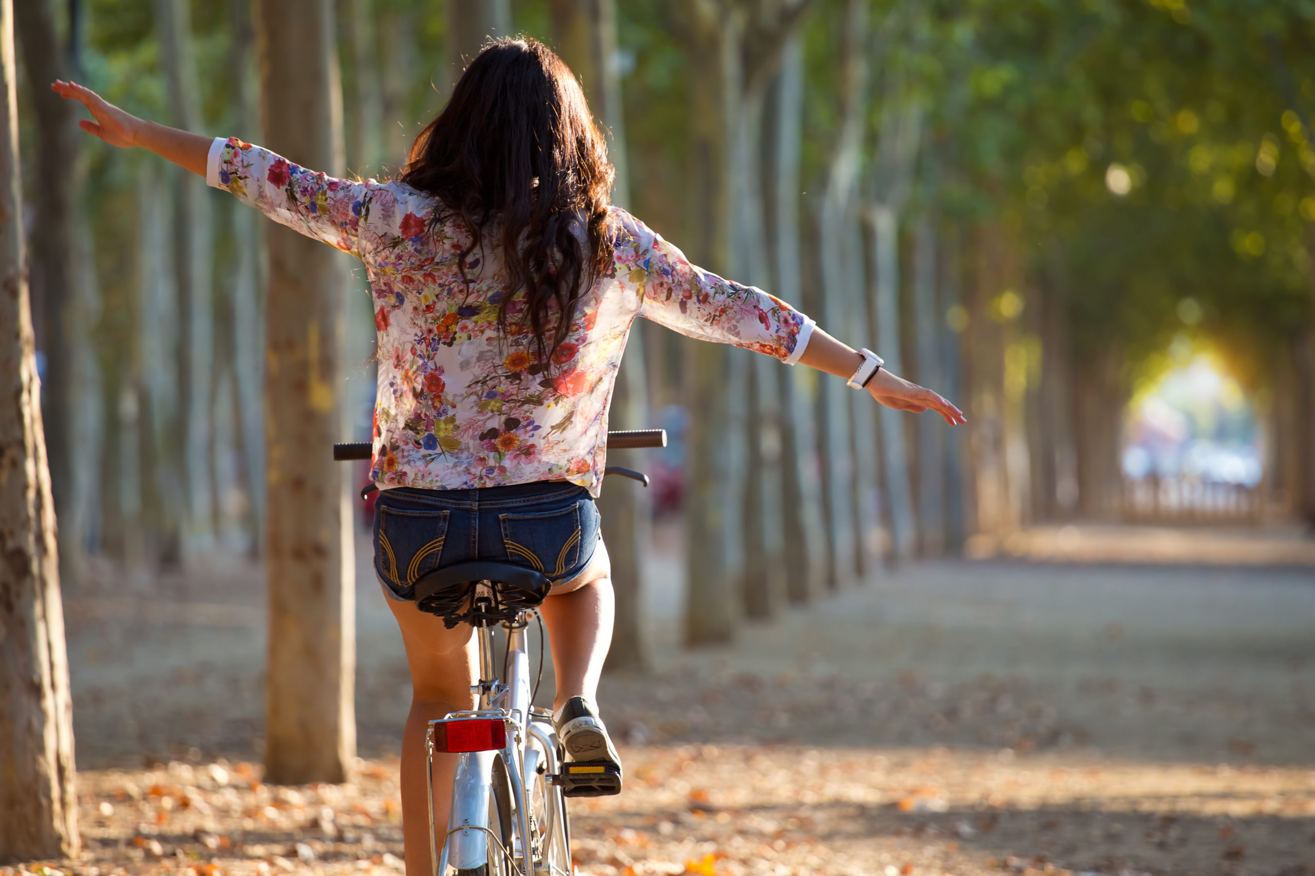 girl riding bike in forest