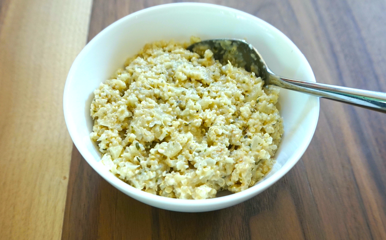 picture of quinoa risotto in a bowl with a spoon